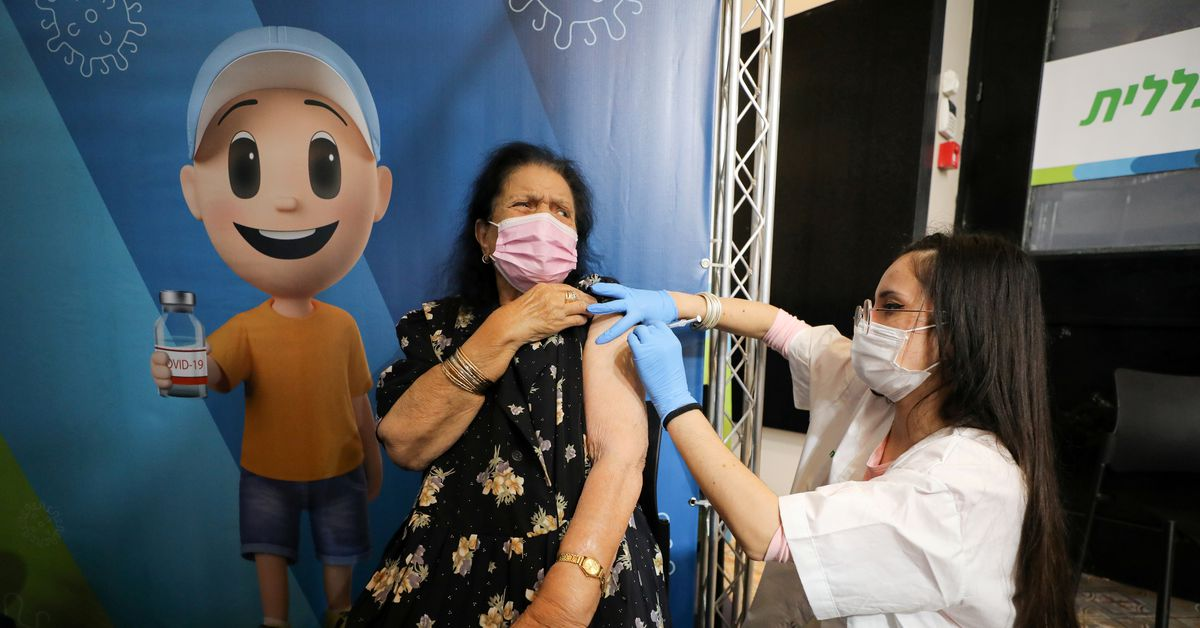 Israel Expands Covid Vaccine Booster Campaign To Over 50s Health Workers Reuters